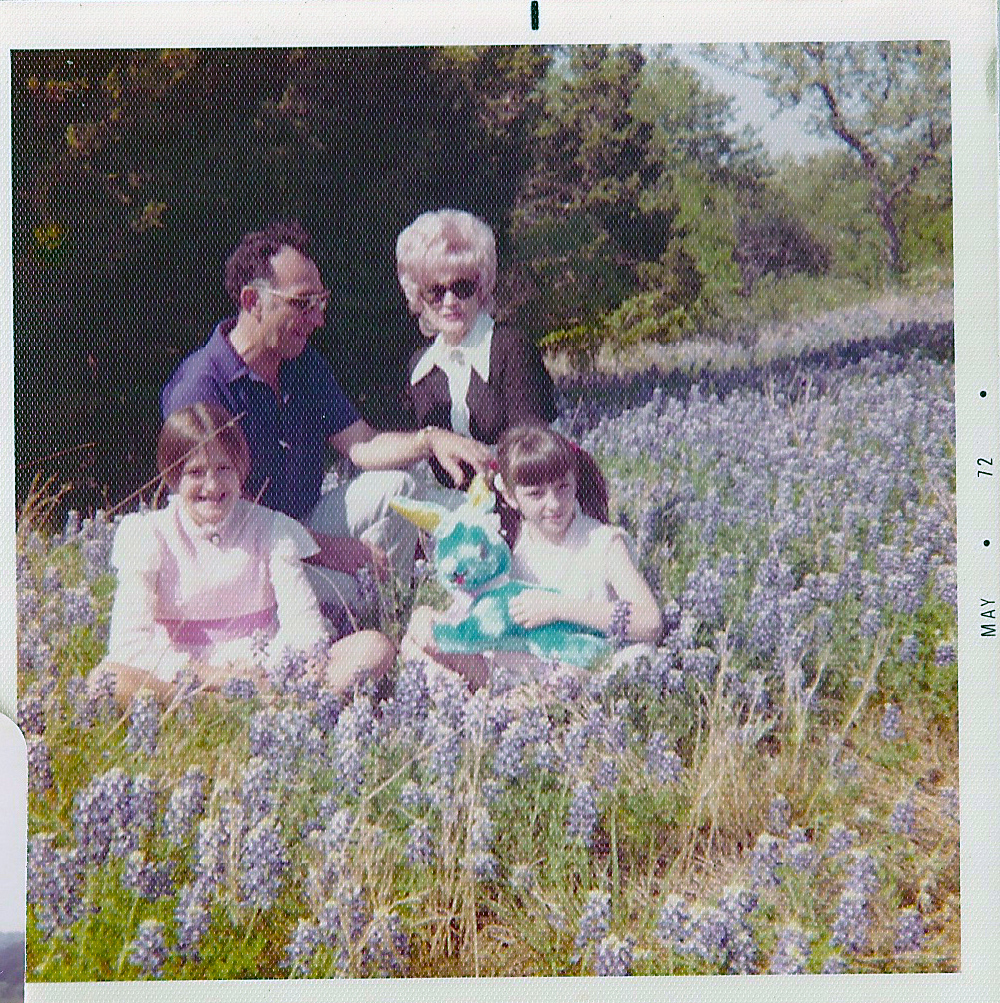 Family in field of bluebonnets. Copyright Kathy Carmichael.