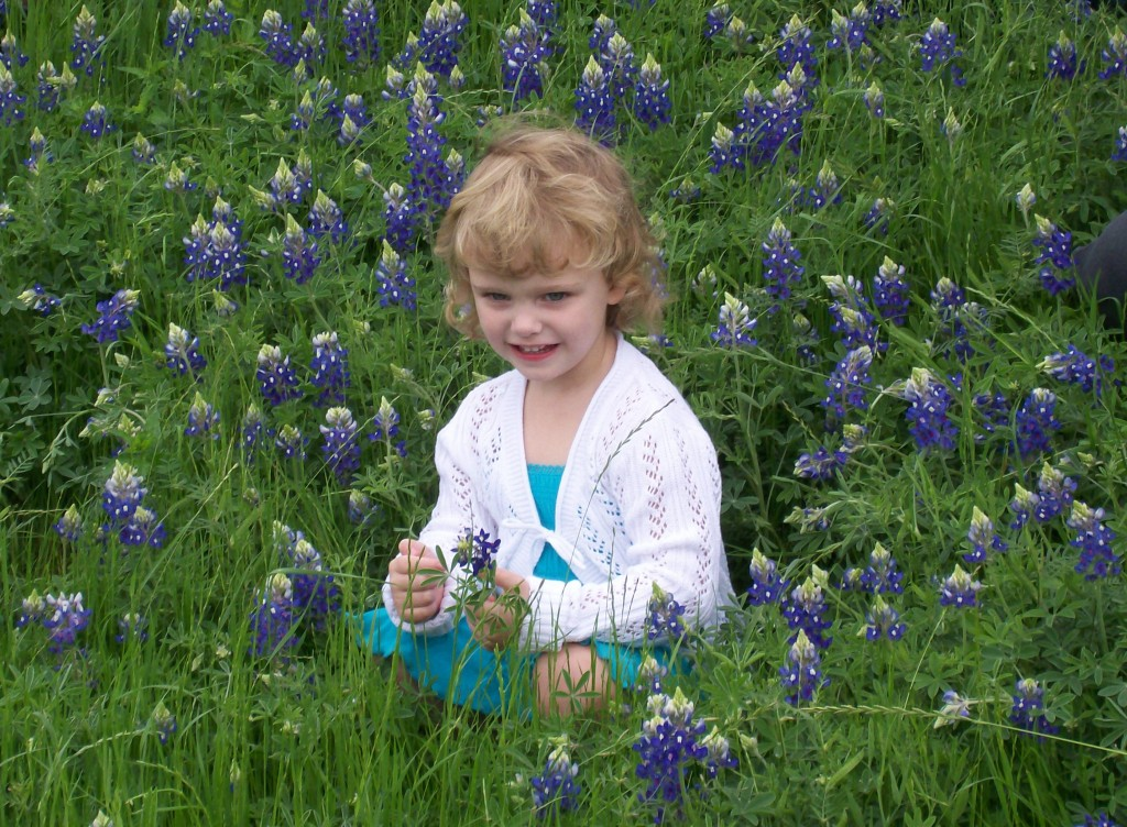Niece in field of bluebonnets. Copyright Kathy Carmichael.